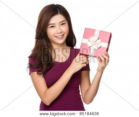 Gift woman in red smiling showing present