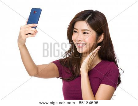 Pretty girl take a self portrait with her smart phone