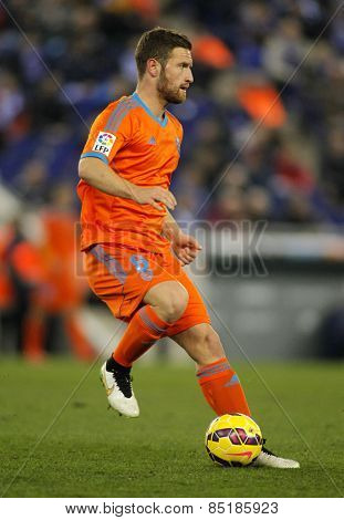 BARCELONA - 8, FEB: Shkodran Mustafi of Valencia CF during spanish League match against RCD Espanyol at the Estadi Cornella on February 8, 2015 in Barcelona, Spain