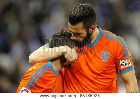 BARCELONA - 8, FEB: Alvaro Negredo embraces Pablo Piatti of Valencia CF during spanish League match against RCD Espanyol at the Estadi Cornella on February 8, 2015 in Barcelona, Spain