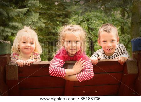 Funny kids enjoying holidays on countryside. Retro style picture