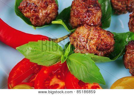 beef meat cutlets served on basil leaf
