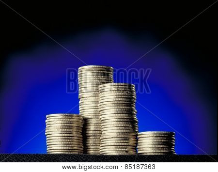 Coin money stack on blue background.