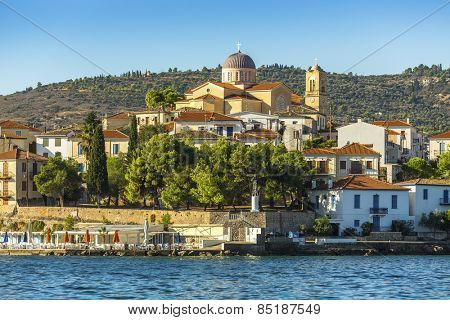 View from the sea of buildings and Ortodox temple of a Greek harbor Galaxidi in Greece.