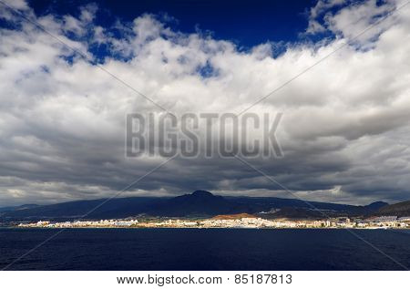 Stormy clouds over Los Cristianos resort in Tenerife, Canary Islands, Spain
