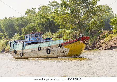 PHNOM PENH, CAMBODIA, JANUARY 2, 2013:  Fishermen's boat on Mekong river