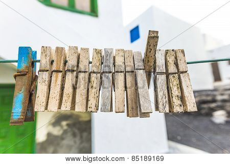 Old Clothespin Under Blue Sky I