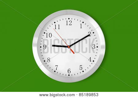 classic clock on green background