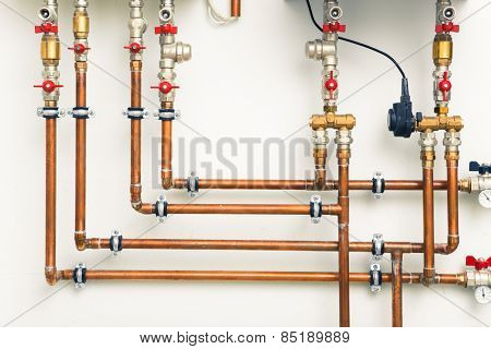 copper pipes in boiler-room
