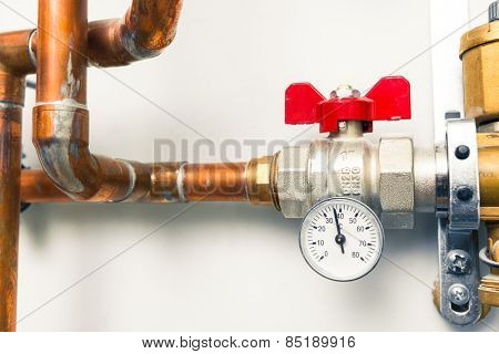 temperature gauge indicator with water tap in boiler-room