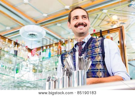 Barista preparing coffee in cafe bar using professional espresso machine