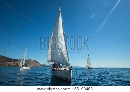 TRIZONIA, GREECE - CIRCA OCT, 2014: Unidentified sailors participate in sailing regatta 12th Ellada Autumn 2014 among Greek island group in the Aegean Sea, in Cyclades and Argo-Saronic Gulf.