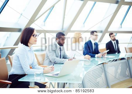 Business people sitting attentively at meeting