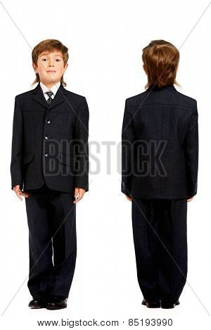 Full length portrait of a boy in a suit, school uniform. Education. Copy space. Isolated over white.