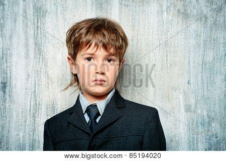 Portrait of a handsome boy in elegant suit. Education. Copy space.