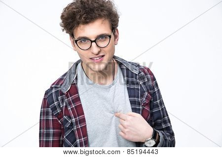 Young man in glasses pointing at himself