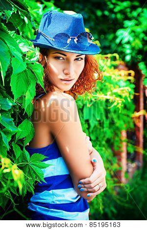 Pretty young woman beautiful foxy hair outdoors. Beauty, fashion.