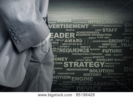 Bottom view of businessman with hands in pockets