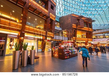 WARSAW, POLAND - 28 FEBRUARY 2014: Interior of the Zlote Tarasy shopping centre in Warsaw, Poland. The total area of the building amounts to 205 000 squere meters with over 200 shops and restaurants.