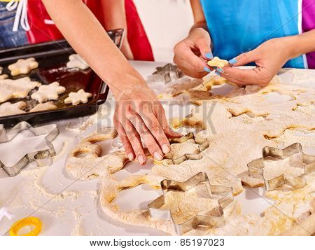 Female hand kneading dough at table.
