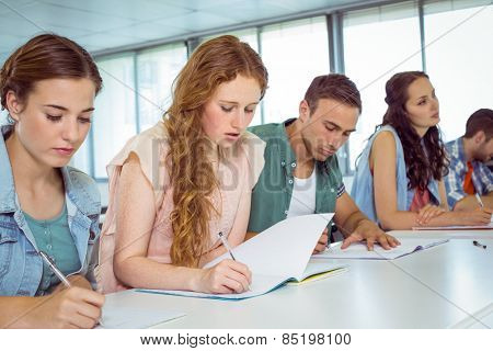 Fashion students taking notes in class at the college