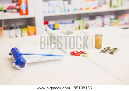 Close up of pills and mortar in the pharmacy
