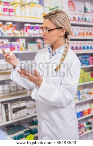 Student looking at prescription and medicine in the pharmacy