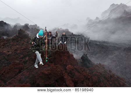 Tourists Hiking On Lava Field Eruption Active Tolbachik Volcano On Kamchatka Peninsula. Russia