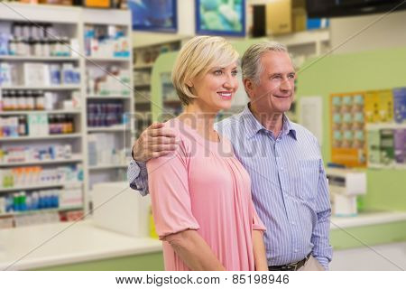 Portrait of couple standing together in the pharmacy