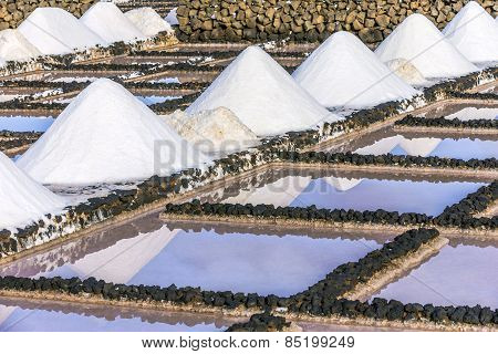 Salt Piles In The Saline Of Janubio