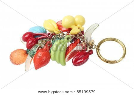 Key Chain With Plastic Fruit Trinket On WHite Background