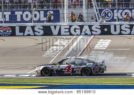 Las Vegas, NV - Mar 08, 2015:  Kevin Harvick (4) does his victory burnout after winning the Kobalt 400 at Las Vegas Motor Speedway in Las Vegas, NV.