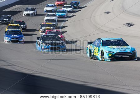 Las Vegas, NV - Mar 08, 2015:  Joey Logano (22) brings his race car through the turns during the Kobalt 400 race at the Las Vegas Motor Speedway in Las Vegas, NV.