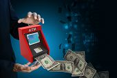 picture of automatic teller machine  - man hand showing teller machine in color background - JPG