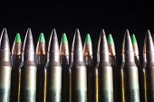 image of piercings  - Cartridges loaded with armor piercing bullets some with green tips - JPG