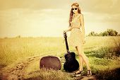 picture of hippy  - Romantic girl travelling with her guitar - JPG