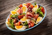 stock photo of smoked ham  - Boiled eggs with smoked ham and vegetables - JPG