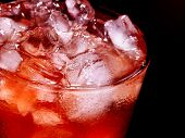 stock photo of cold drink  - Red cube ice of cold drink  with  on dark background - JPG