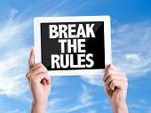 foto of misbehaving  - Tablet pc with text Break the Rules with sky background - JPG