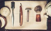 foto of barber razor  - Shaving accessories on a luxury wooden background  - JPG