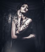 image of spooky  - Tattooed beautiful woman in old spooky interior - JPG