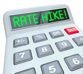 image of calculator  - Rate Hike words in green letters on a calculator display to illustrate increased interest costs in borrowing money in a loan - JPG
