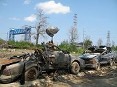 picture of katrina  - cars demolished when tossed around in the flood waters of Katrina still sit in the Lower Ninth Ward of New Orleans - JPG