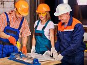 pic of millwright  - Happy group people builder cutting ceramic tile - JPG
