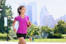 picture of cardio exercise  - Run woman exercising in Central Park New York City with urban background of skyscrapers skyline - JPG