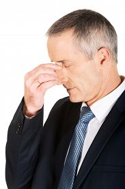 pic of sinuses  - Mature businessman suffering from sinus pain - JPG