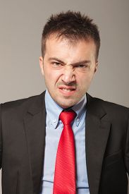 stock photo of disapproval  - Young business man making a disapproving face - JPG