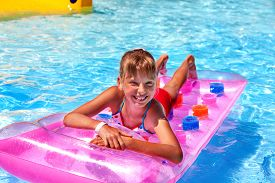 picture of inflatable slide  - Child female on water slide at aquapark - JPG