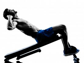 image of sitting a bench  - one caucasian man exercising fitness crunches crunches Bench Press exercises in studio silhouette isolated on white background - JPG