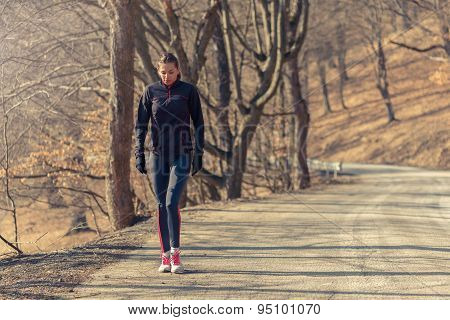 Woman Relaxing After A Long Run In The Woods